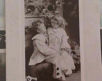 "Vintage Real Photo Postcard of Children "" Love's Lightest Burden"""