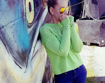 Knitted summer sweater in beautiful bright green colour. Lovely deatailed sleeves and top.