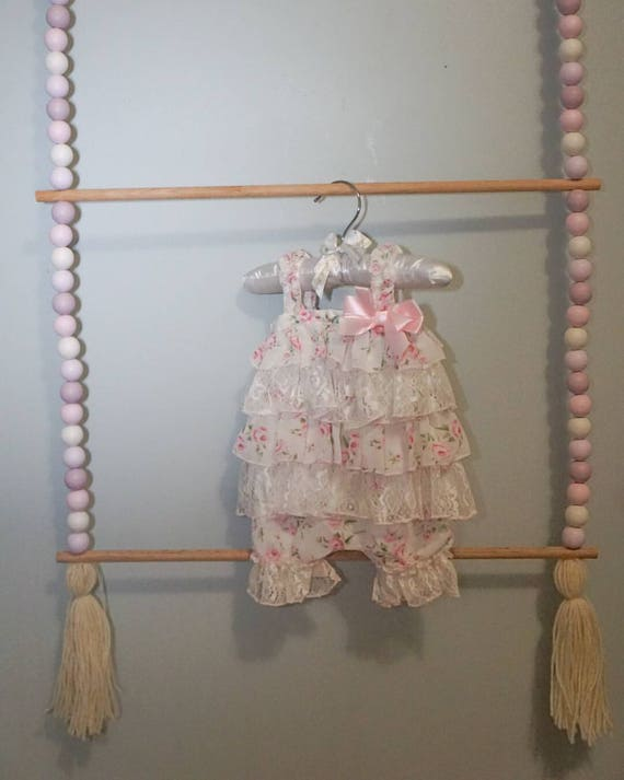 A Beaded Hanging Rack for Kids Room or Nursery