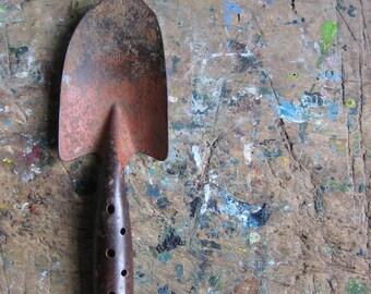 A vintage French metal trowel, vintage gardening tool, metal handle