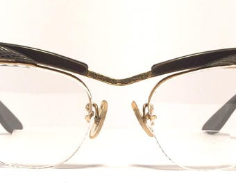 Vintage eyewear. Cat eye style. Bausch&Lomb 1950's. Dark brown color with unique textured details. Gold filled. Excellent quality! Beauty!