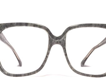 Vintage eyewear. Made in Italy 1980's by Lozza. Ice gray color. Excellent quality and condition! Nice large size. Cool Hip Urban Mod Woman!