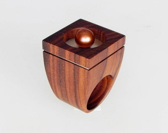 Wooden ring with natural pearls.