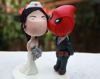 Deadpool Groom and Nurse Bride. Kiss on the cheek. Wedding cake topper. Wedding figurine. Handmade. Fully customizable. Unique keepsake