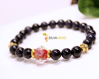 Sparkling Navy Blue Goldstone Stretchy Bracelet with Red and Yellow Golden Rose Spacers - Free Delivery. Birthday Gift. Bracelet for Her.