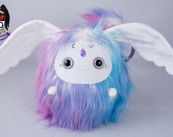 Flibble sprite wing eared creature in pastel pink, blue, purple mix; iridescent drop accent and Swarovski crystals