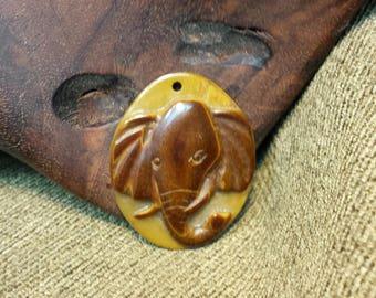 Elephant in Tiger Eye 40x32x8mm