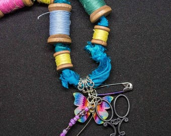 Quirky, boho upcycled cotton reel statement necklace. Scissor pendant, Recycled sari silk, buttons and beads. Gifts for her