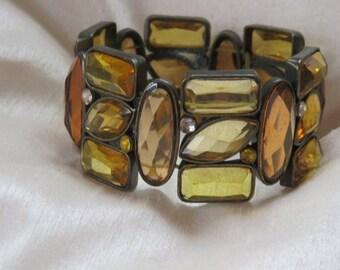Vintage Amber,gold colour faceted glass elasticated bracelet
