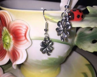Sterling silver hooked lucky four leafed clover earrings.