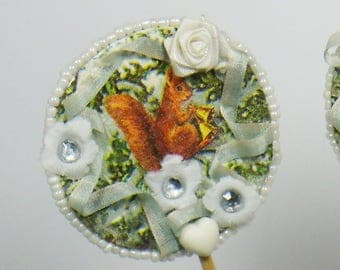Decorative spike Shabby chic squirrel and trees in snow, ribbons and flowers