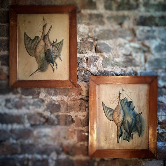 A pair of continental printed and embossed pictures of game birds after Michelangelo Meucci