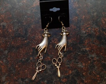 silver hands with scissors earrings.