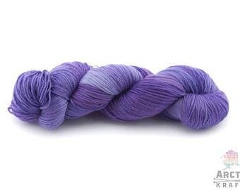 Gluttony, hand dyed yarn. DK weight 1ply superwash merino/silk, merino/nylon, merino/tussah silk.Indie dyed semi solid purple yarn.