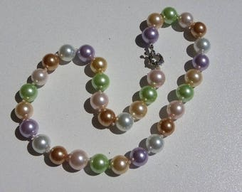 Necklace pearls of coquillage12 mm with beautiful colors