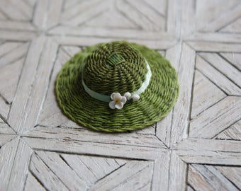 A miniature green hat