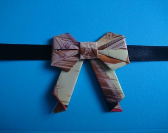 ten small comic book paper Origami bows, gift wrapping