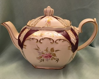 Sadler Teapot from England 1940s, ecru, burgundy and gold with roses. No chips or flaws.