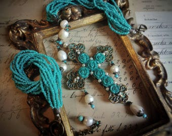 Cross with turquoise roses