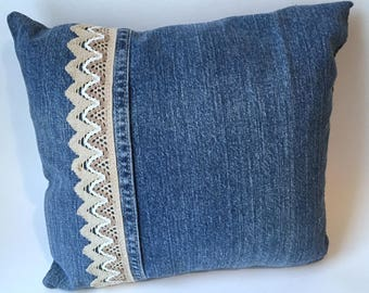 OOAK pillow made from repurposed jeans trimmed with three tone beige woven trim