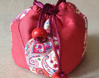 Small decorative bag in red silk rose and cotton for her jewelry.