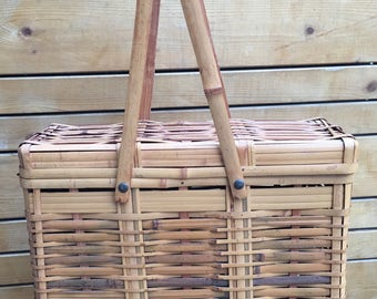 Rare and unique shaped Mid century Japanese  split cane Bamboo picnic basket. Unique shaped split cane Bamboo purse with long handles.