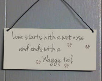 Love starts with a wet nose and ends with a waggy tail. Metal hanging sign