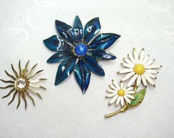 Costume Jewelry Lot of Colorful Brooches. Sunburst theme Sarah Cov, Shasta Daisies and a large blue floral. All in good used condition.