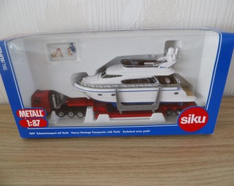 Model construction of Metal 1:87, SIKU, heavy transport with hunting