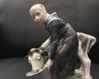 Royal Copenhagen Girl with a Calf Figurine Made in Denmark, Signed and numbered 779.