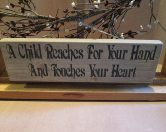 A Child Reaches For Your Hand ... wooden sign