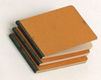 Three 1940s grid paper notepads. 50 sheets each, size A6. Unused.