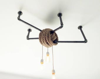 Industrial hemp rope and black cast iron chandelier