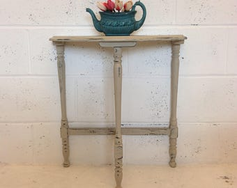 Demi lune hall/display table with french script top