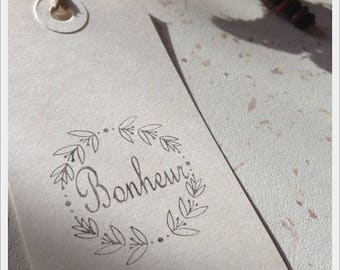 Not mounted rubber stamp with writing * happiness * 3.5 cm diameter