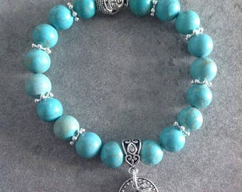 Please energized Bracelet be please in turquoise blue magnesite 10mm bead silver zen Buddha and Ohm charm