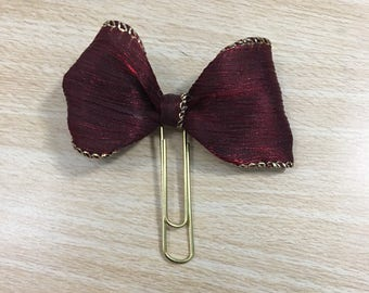 Gold and maroon bow clip