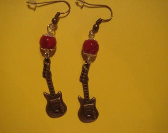 Dangling earrings, electric guitar