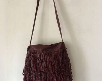 Real handmade crossbody bag, from soft recycling leather with elements of fashionable leather fringe new women's burgundy bag size-medium.