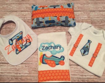 Custom baby gift set; quilted diaper wipe case, personalized bib, personalized burp rag and onsie