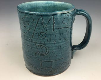 Blue mug with images of beasts on both sides