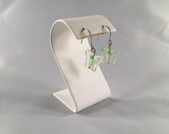 Clear glass butterfly earrings with a hint of green