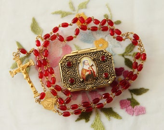 Vintage Brass & Ruby Red Glass St. Therese Catholic Rosary with Matching Case – Czechoslovakia