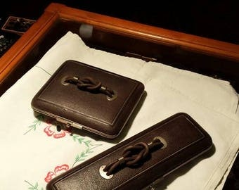 A matching pair of Victorian tooled leather boxes. One for gloves & one for handkerchiefs. Each box is conertinaed with a celtic knot handle