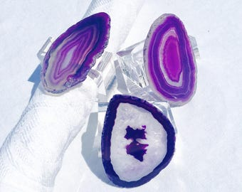Purple agate napkin rings:  Geode slice on clear rectangular lucite