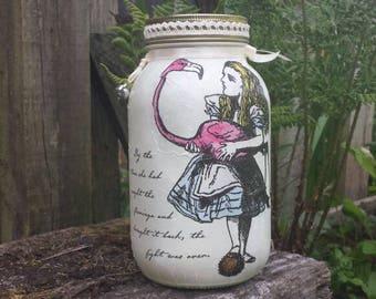 Alice mason jar. Alice and flamingo decoupage jar with quote and teapot charm.