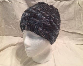 Hand knitted beanie hat made with hand dyed black gradient yarn