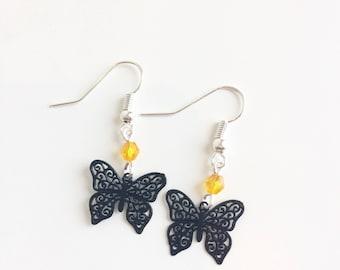 Black butterflies and orange beads earrings