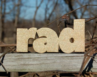 RAD sign made from cedar treehouse scraps