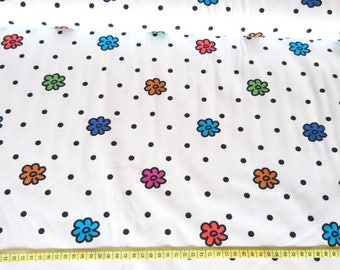 Lovely summary floral and polka Dots cotton jersey fabric, one unit is 0.5m